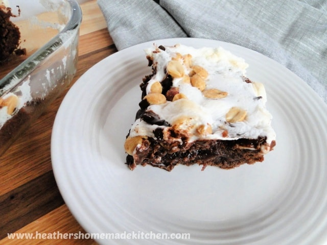 Close up view of Rocky Road Brownies slice on white round plate.