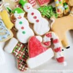Assorted Sugar Cookie Cut Outs decorated with colored royal icing on square platter.