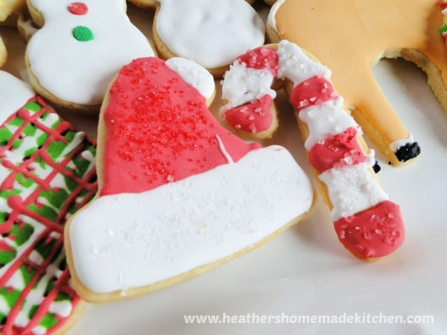 Sugar Cookie Cut Outs decorated santa hat and candy cane.