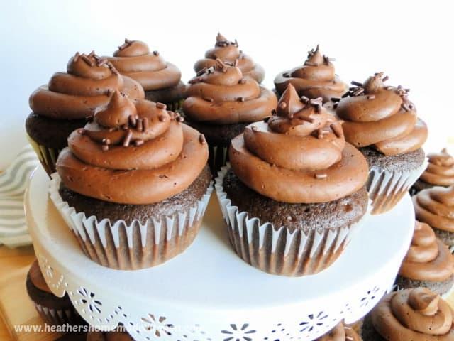 Homemade chocolate cupcakes on cake stand.