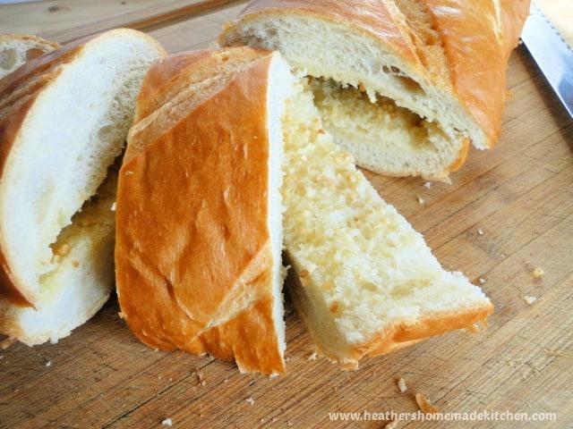 Easy Peasy Garlic Bread sliced on board.
