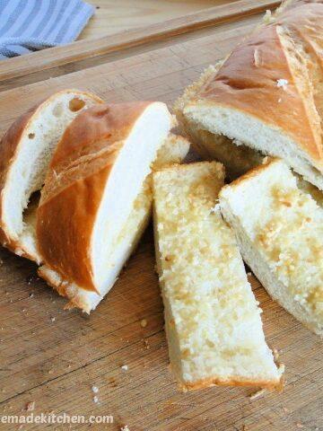 Easy Peasy Garlic Bread on board and sliced.