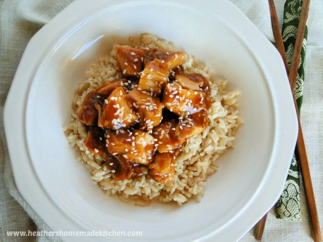 Top view of instant pot honey garlic chicken over rice in white bowl.
