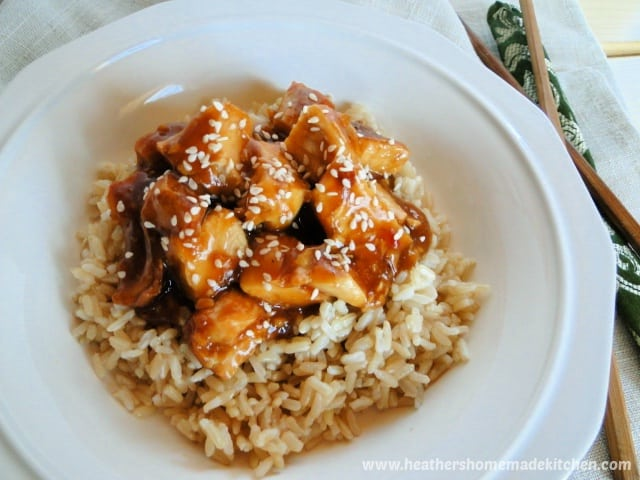 instant pot honey garlic chicken over rice in white bowl.