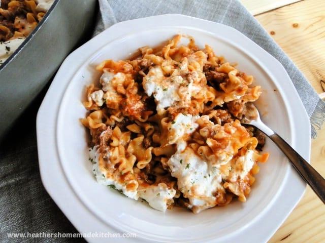 Bowl of skillet lasagna with fork next to skillet.