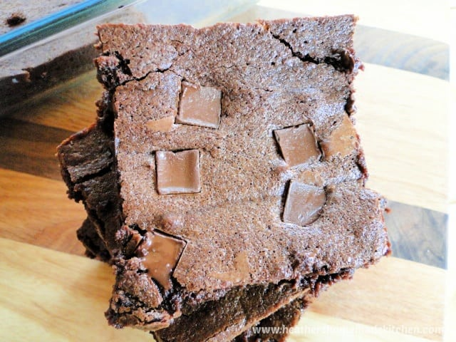 Top view of classic homemade brownies with chocolate chunks on top.