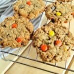 Easy chewy Monster Cookies in rows on cooling rack.
