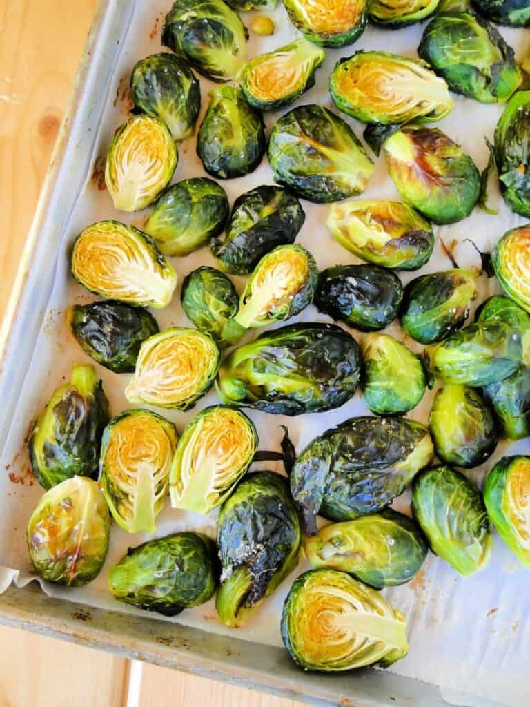 Top view of oven roasted brussels sprouts on sheet pan.