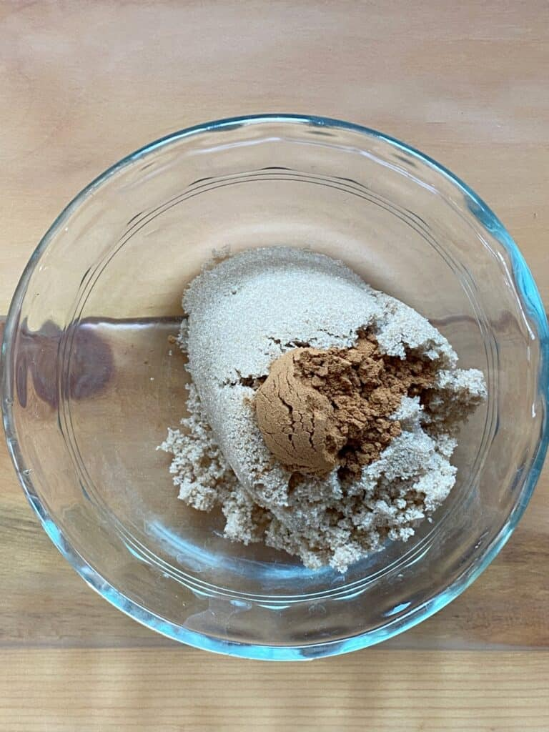 Brown sugar and cinnamon in a small glass bowl.