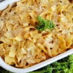 Chicken and noodles in white casserole dish.