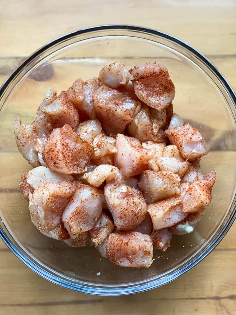 Diced chicken breast seasoned.