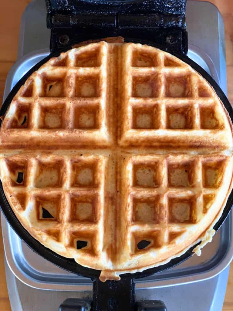 Cooked belgain waffle in waffle iron.