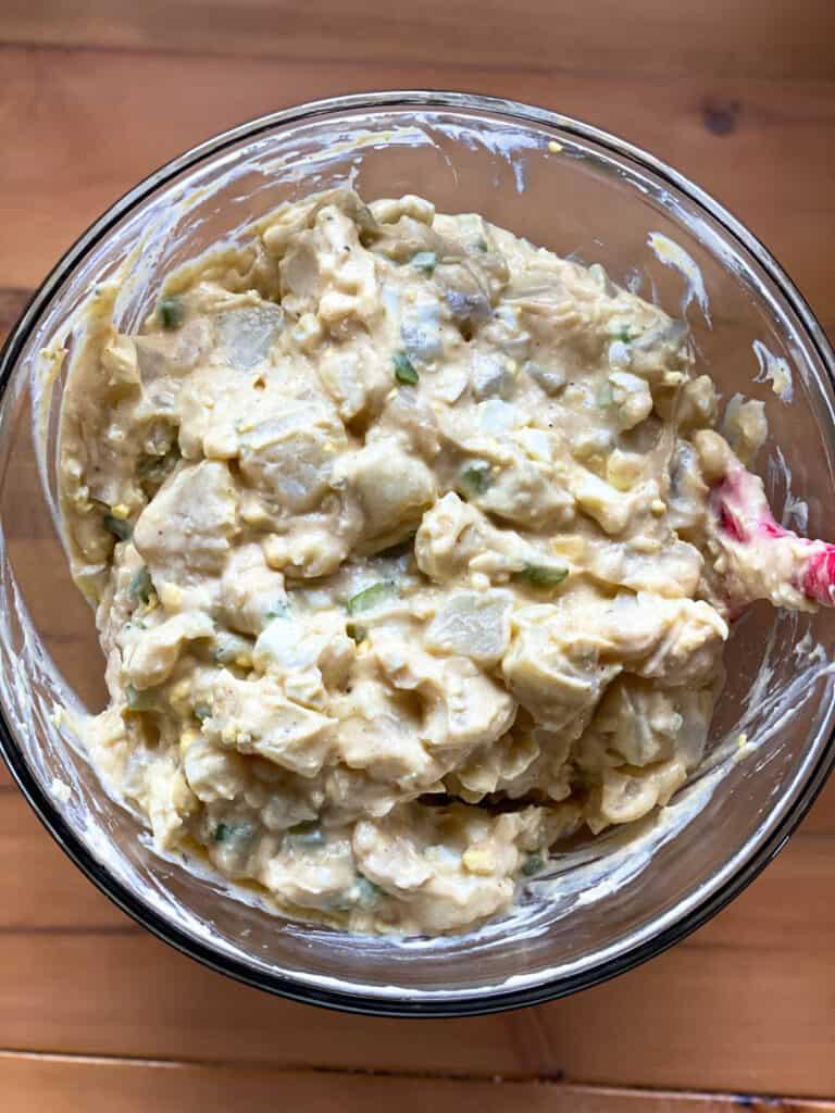 Fully mixed classic potato salad.
