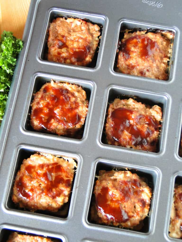 Top view of mini bbq turkey meatloaves in pan.