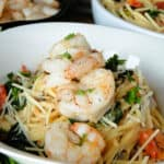 Close up view of Easy spaghetti shrimp in white bowl.