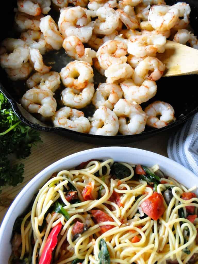 Pan of garlic shrimp and bowl of one pot pasta.