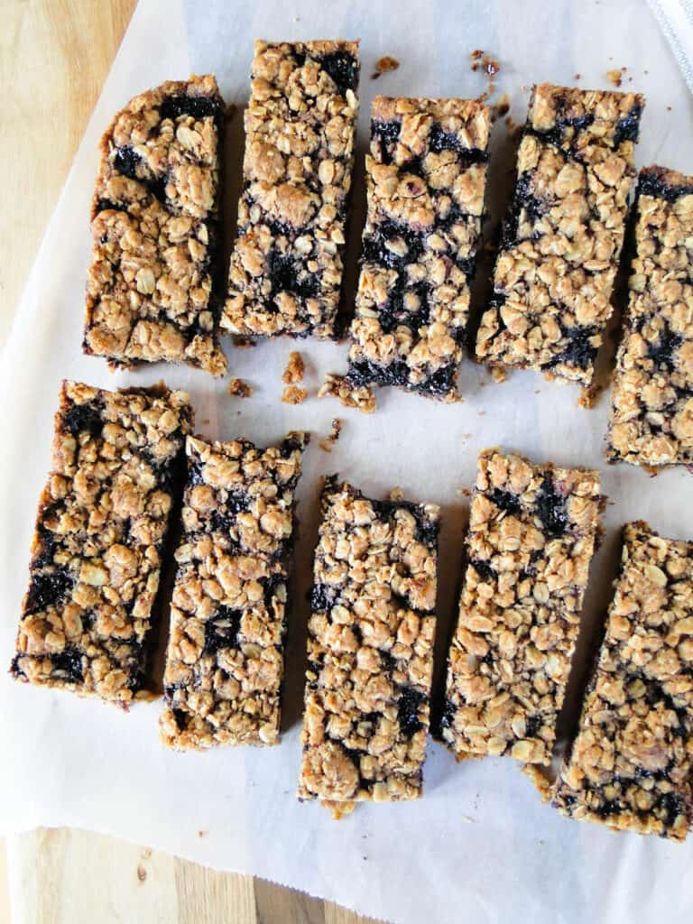Top view of sliced blueberry cereal bars on parchment paper.