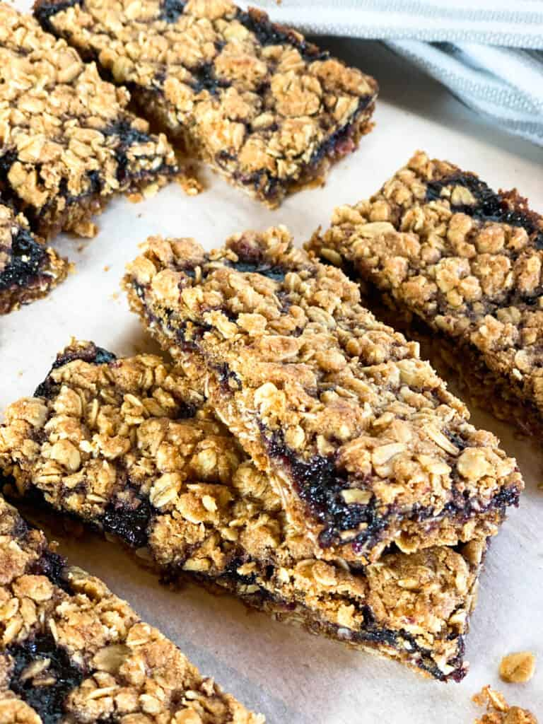 Close up view of sliced blueberry bars.