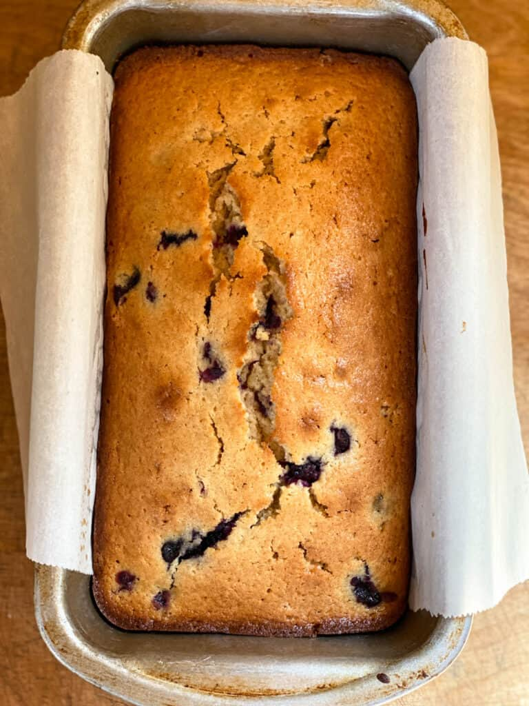 Baked blueberry bread in loaf pan.