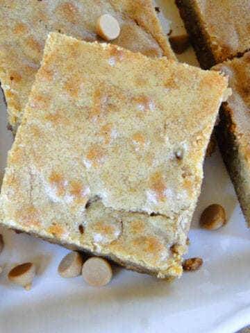 Butterscotch brownies cut into squares showing crackled top.