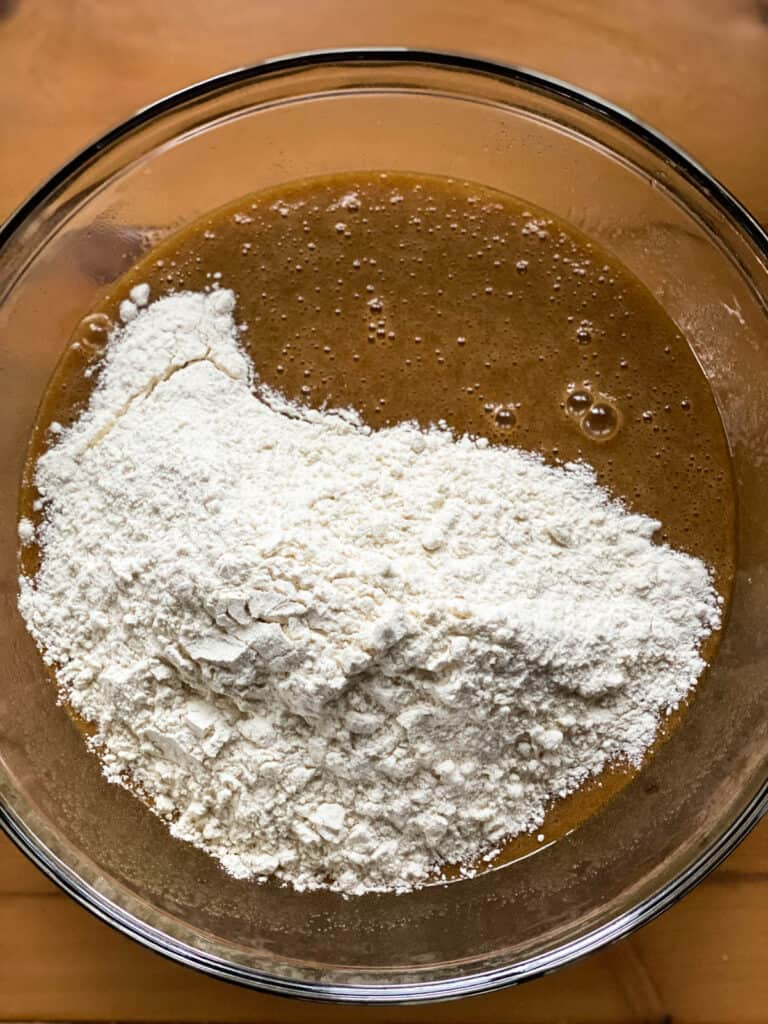 Dry ingredients added to wet in large glass bowl.