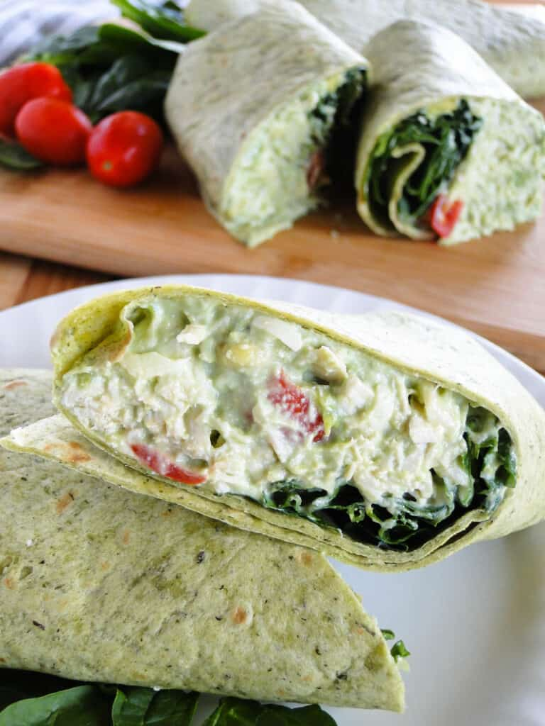 Close up view of the chicken avocado salad inside the wrap.