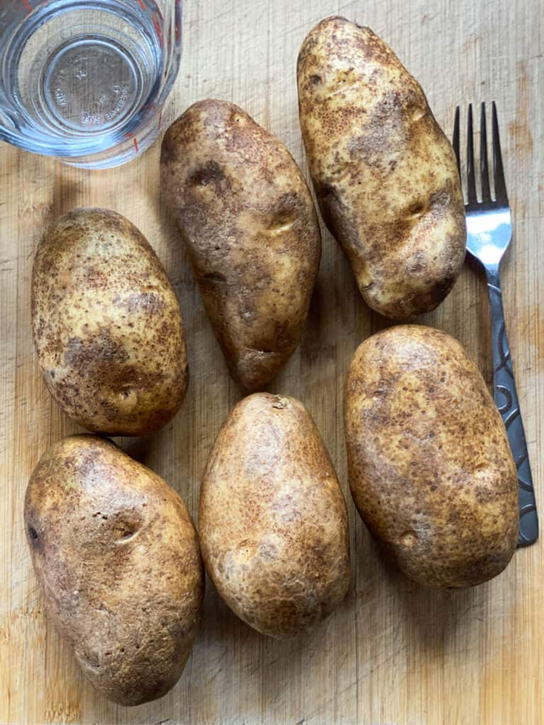 Potatoes scrubbed clean, pierced with fork and ready for the instant pot.