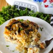 Bite on fork from slice of crock pot breakfast casserole on plate.