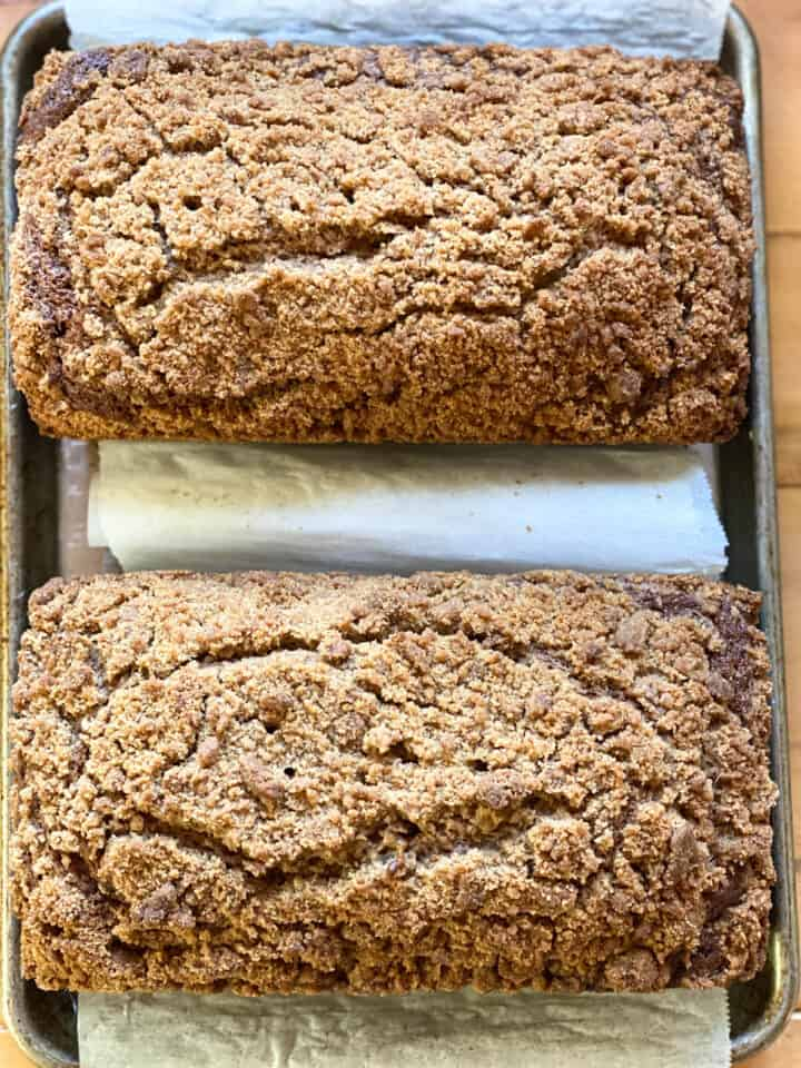 Baked crumb topped banana bread out of loaf pans.