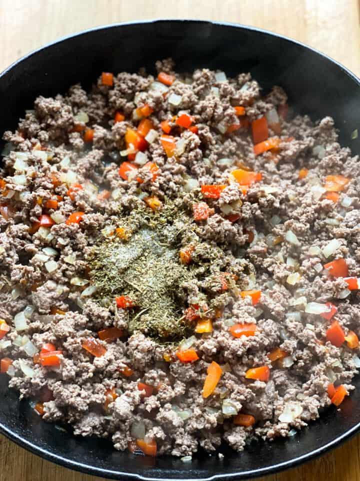 Italian seasonings added to cooked beef and veggies.
