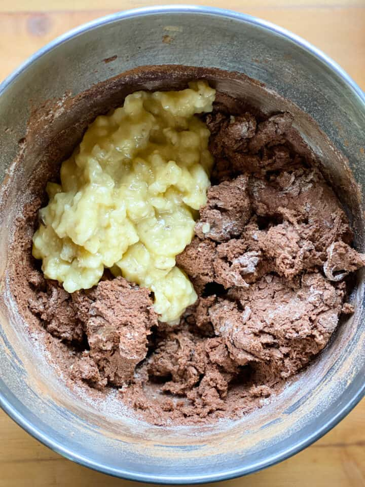 Dry ingredients mixed in then mashed bananas added.
