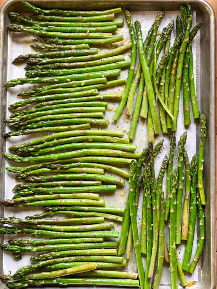Asparagus prepared and placed in single layer on sheet pan.