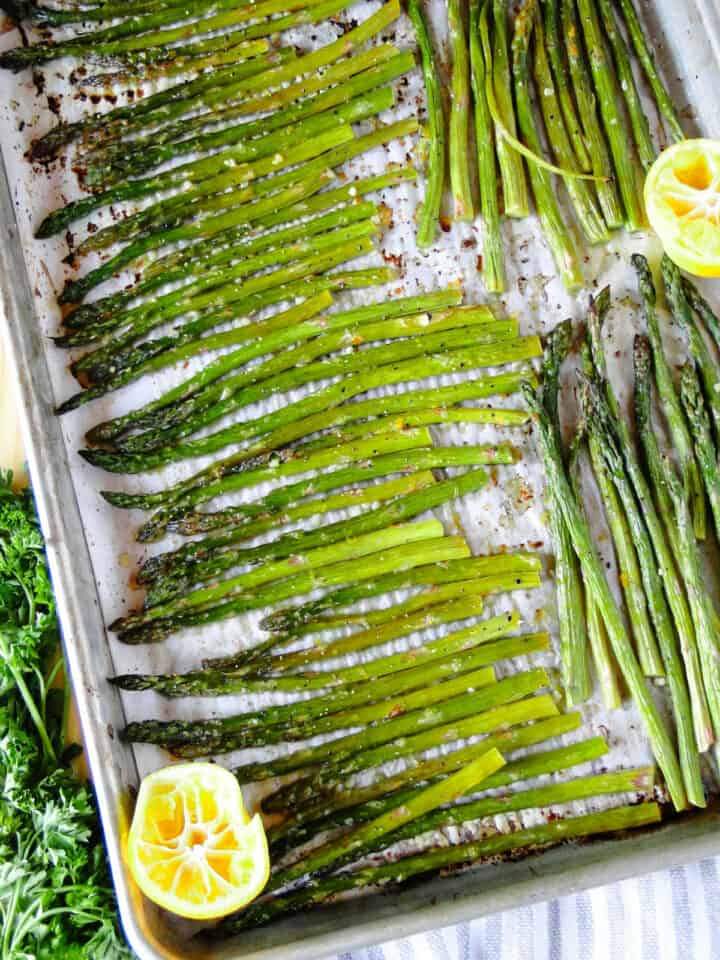 Top view of roasted asparagus on sheet pan.