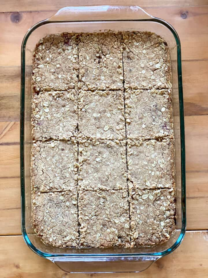 Baked strawberry rhubarb oat bars in baking dish.