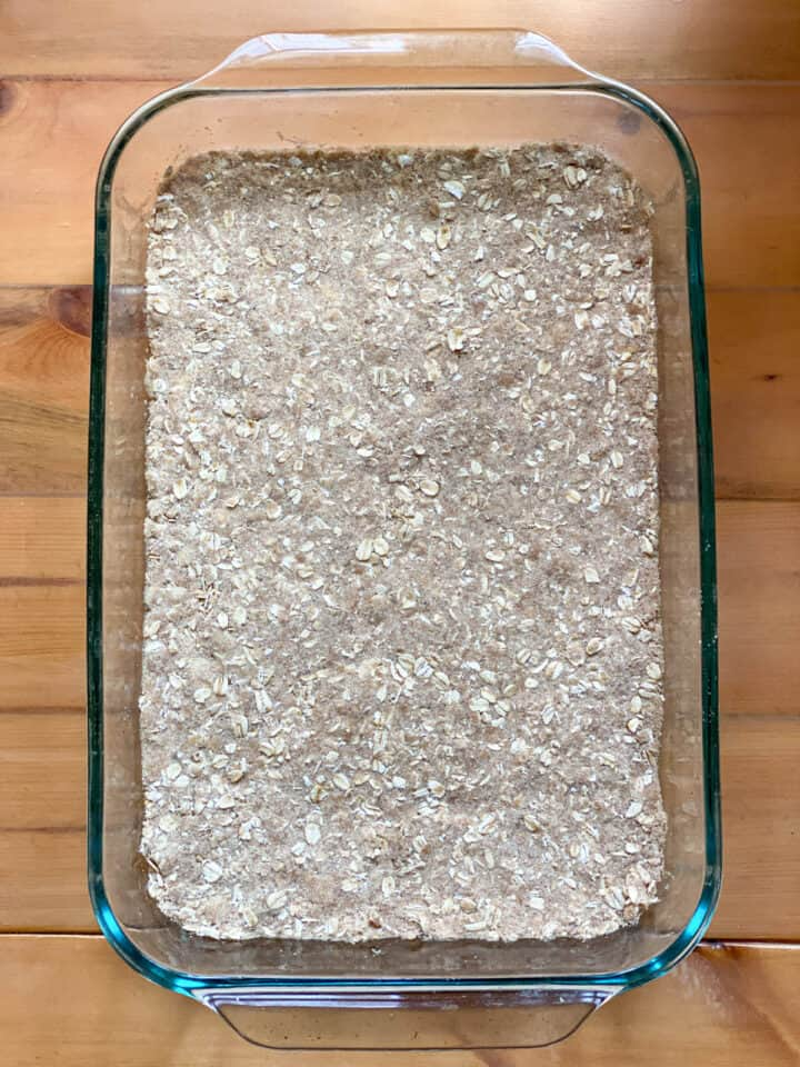 Oat crust packed into baking dish.
