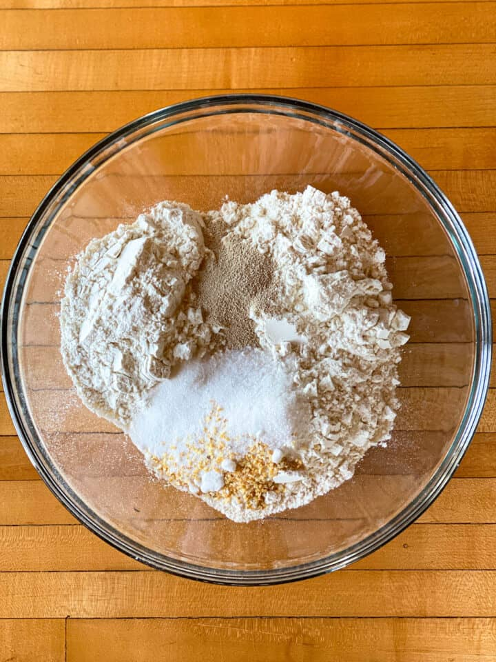 Dry ingredients mixed in large glass bowl.
