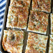 Close up top view of sliced garlic parmesan focaccia bread.