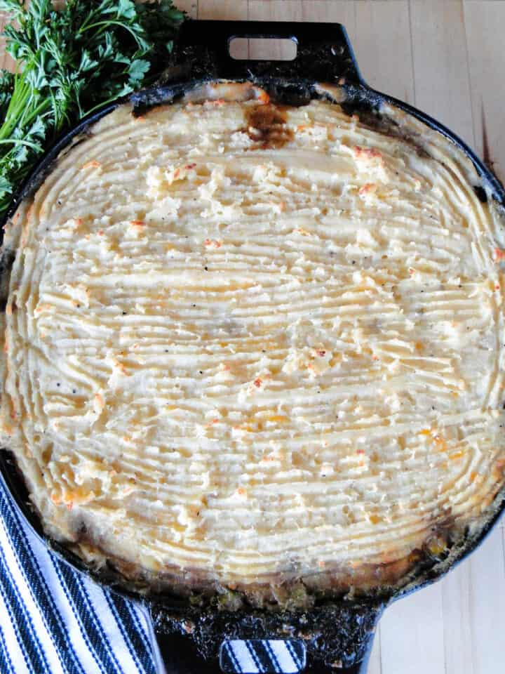 Top view of baked homemade shepherd's pie in cast iron dish.