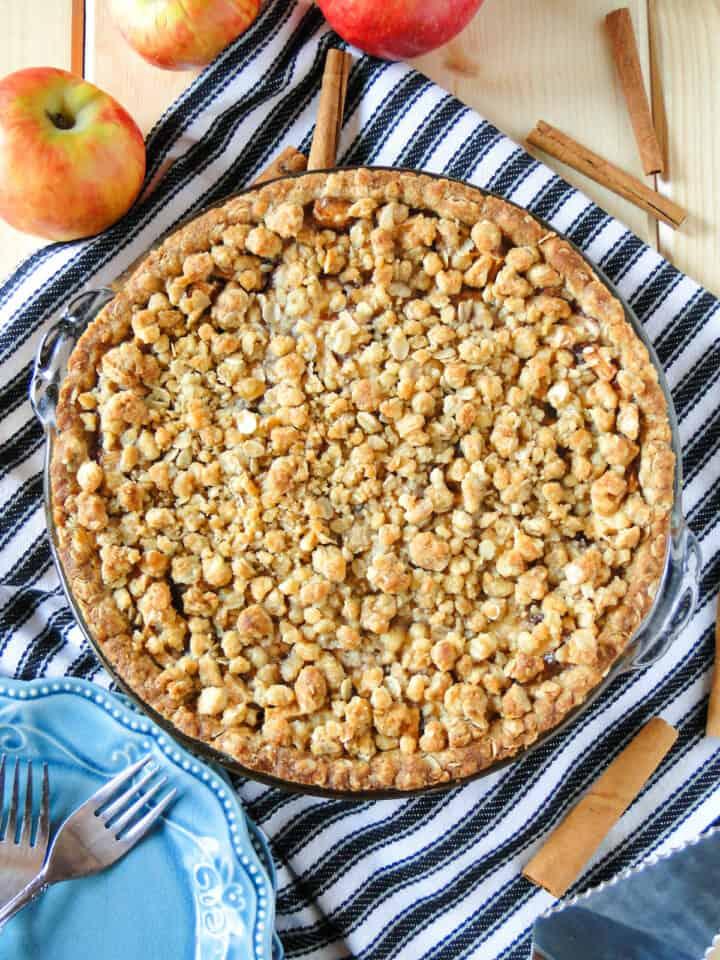 Top view of baked full apple crisp pie.