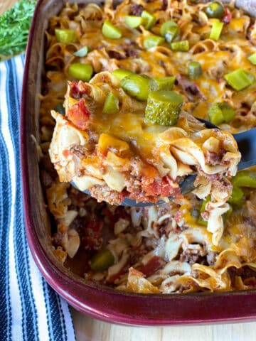 Easy cheeseburger casserole being scooped out of casserole dish.